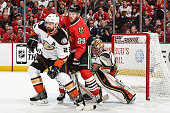 Francois Beauchemin of the Anaheim Ducks and Bryan Bickell of the Chicago Blackhawks wait in position in front of goalie Frederik Andersen in Game...