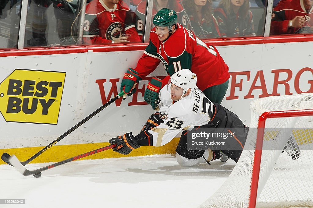 <a gi-track='captionPersonalityLinkClicked' href=/galleries/search?phrase=Francois+Beauchemin&family=editorial&specificpeople=604125 ng-click='$event.stopPropagation()'>Francois Beauchemin</a> #23 of the Anaheim Ducks and <a gi-track='captionPersonalityLinkClicked' href=/galleries/search?phrase=Zach+Parise&family=editorial&specificpeople=213606 ng-click='$event.stopPropagation()'>Zach Parise</a> #11 of the Minnesota Wild battle for control of the puck along the boards during the game on March 12, 2013 at the Xcel Energy Center in Saint Paul, Minnesota.