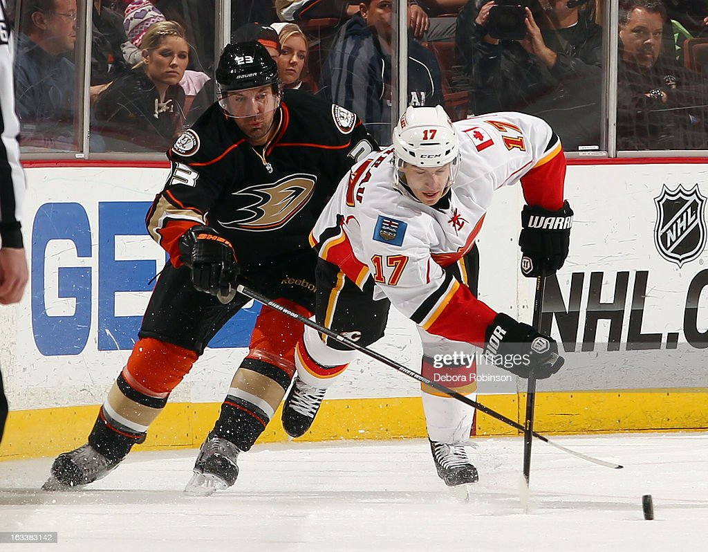 Francois Beauchemin #23 of the Anaheim Ducks battles for the puck against Blake Comeau #17 of the Calgary Flames on March 8, 2013 at Honda Center in Anaheim, California.
