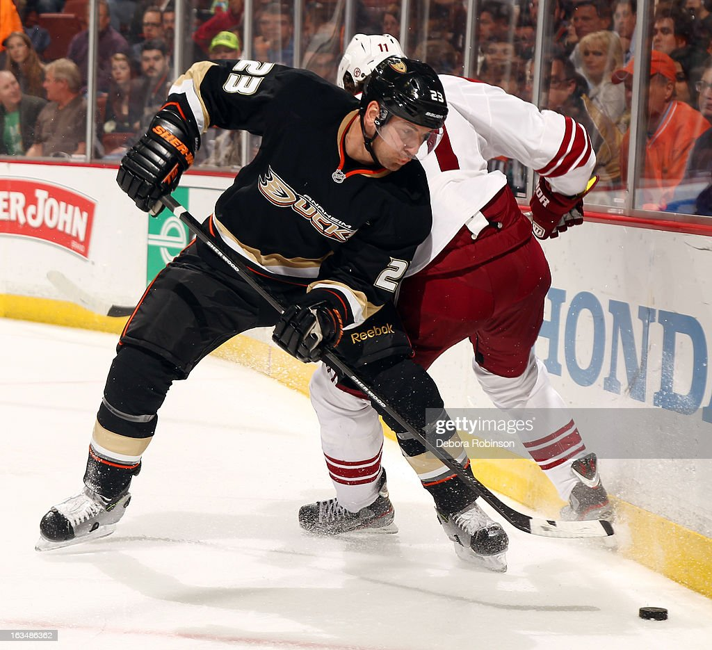 Francois Beauchemin #23 of the Anaheim Ducks battles for the puck against Martin Hanzal #11 of the Phoenix Coyotes on March 6, 2013 at Honda Center in Anaheim, California.
