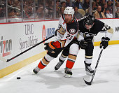 Francois Beauchemin of the Anaheim Ducks battles for the puck against Patric Hornqvist of the Pittsburgh Penguins at Consol Energy Center on October...