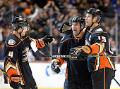 Francois Beauchemin of the Anaheim Ducks celebrates his power play goal with Ryan Getzlaf and Cam Fowler to trail 21 to the New York Rangers during...