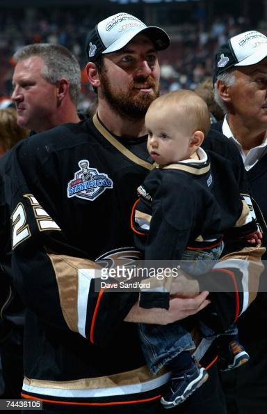 Francois Beauchemin of the Anaheim Ducks celebrates with his child after defeating the Ottawa Senators in Game Five of the 2007 Stanley Cup finals on...