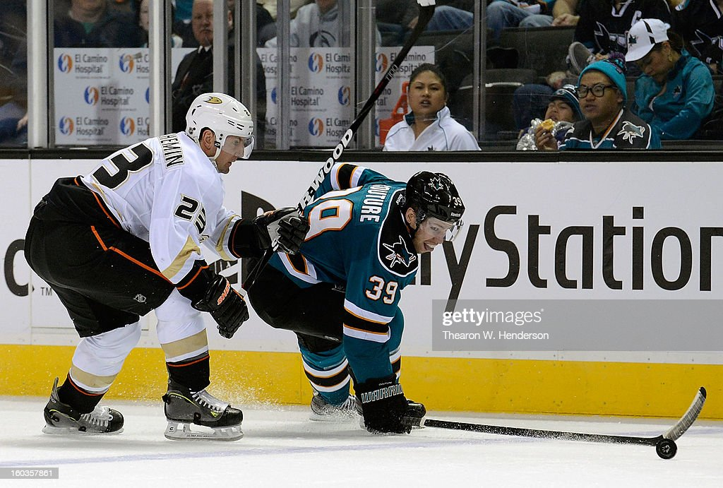 <a gi-track='captionPersonalityLinkClicked' href=/galleries/search?phrase=Francois+Beauchemin&family=editorial&specificpeople=604125 ng-click='$event.stopPropagation()'>Francois Beauchemin</a> #23 of the Anaheim Ducks checks <a gi-track='captionPersonalityLinkClicked' href=/galleries/search?phrase=Logan+Couture&family=editorial&specificpeople=809700 ng-click='$event.stopPropagation()'>Logan Couture</a> #39 of the San Jose Sharks as Couture battles to keep control of the puck in the second period at HP Pavilion on January 29, 2013 in San Jose, California. The Sharks won the game 3-2 in a shoot-out.