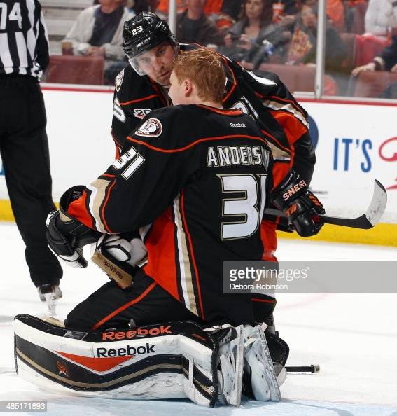 Francois Beauchemin of the Anaheim Ducks checks on teammate Frederik Andersen during the game against the Dallas Stars in Game One of the First Round...