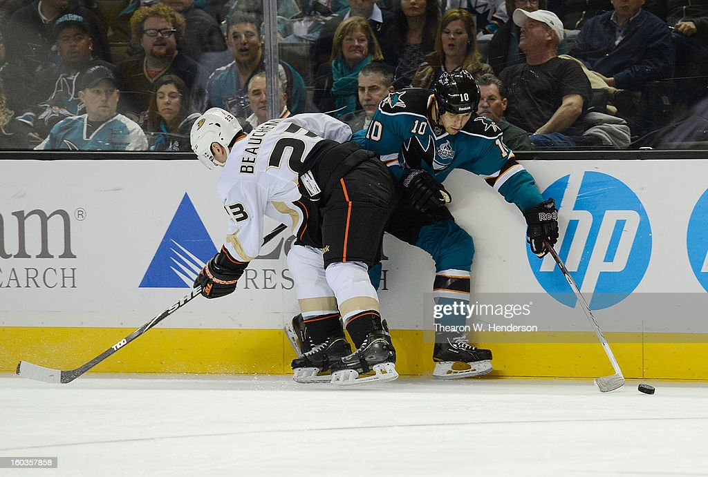 <a gi-track='captionPersonalityLinkClicked' href=/galleries/search?phrase=Francois+Beauchemin&family=editorial&specificpeople=604125 ng-click='$event.stopPropagation()'>Francois Beauchemin</a> #23 of the Anaheim Ducks collides with <a gi-track='captionPersonalityLinkClicked' href=/galleries/search?phrase=Andrew+Desjardins&family=editorial&specificpeople=2748431 ng-click='$event.stopPropagation()'>Andrew Desjardins</a> #10 of the San Jose Sharks in the second period at HP Pavilion on January 29, 2013 in San Jose, California. The Sharks won the game 3-2 in a shoot-out.