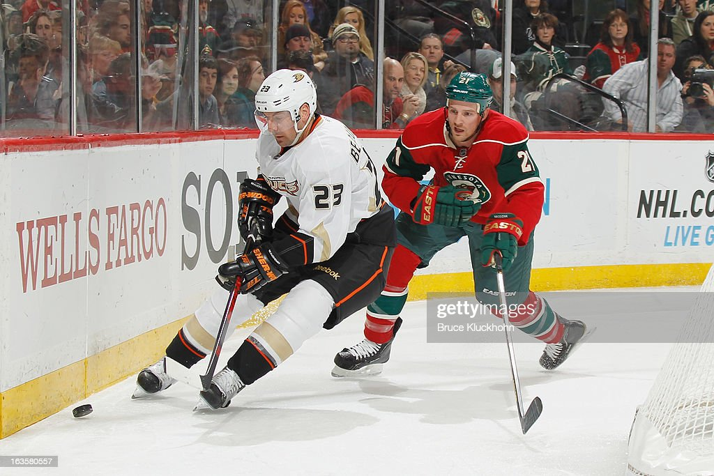 <a gi-track='captionPersonalityLinkClicked' href=/galleries/search?phrase=Francois+Beauchemin&family=editorial&specificpeople=604125 ng-click='$event.stopPropagation()'>Francois Beauchemin</a> #23 of the Anaheim Ducks controls the puck nears the boards while <a gi-track='captionPersonalityLinkClicked' href=/galleries/search?phrase=Kyle+Brodziak&family=editorial&specificpeople=2165412 ng-click='$event.stopPropagation()'>Kyle Brodziak</a> #21 of the Minnesota Wild defends during the game on March 12, 2013 at the Xcel Energy Center in Saint Paul, Minnesota.
