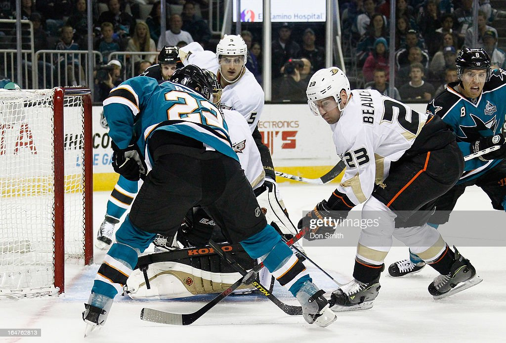 <a gi-track='captionPersonalityLinkClicked' href=/galleries/search?phrase=Francois+Beauchemin&family=editorial&specificpeople=604125 ng-click='$event.stopPropagation()'>Francois Beauchemin</a> #23 of the Anaheim Ducks defends against <a gi-track='captionPersonalityLinkClicked' href=/galleries/search?phrase=Dan+Boyle&family=editorial&specificpeople=201502 ng-click='$event.stopPropagation()'>Dan Boyle</a> #22 of the San Jose Sharks during an NHL game on March 27, 2013 at HP Pavilion in San Jose, California.