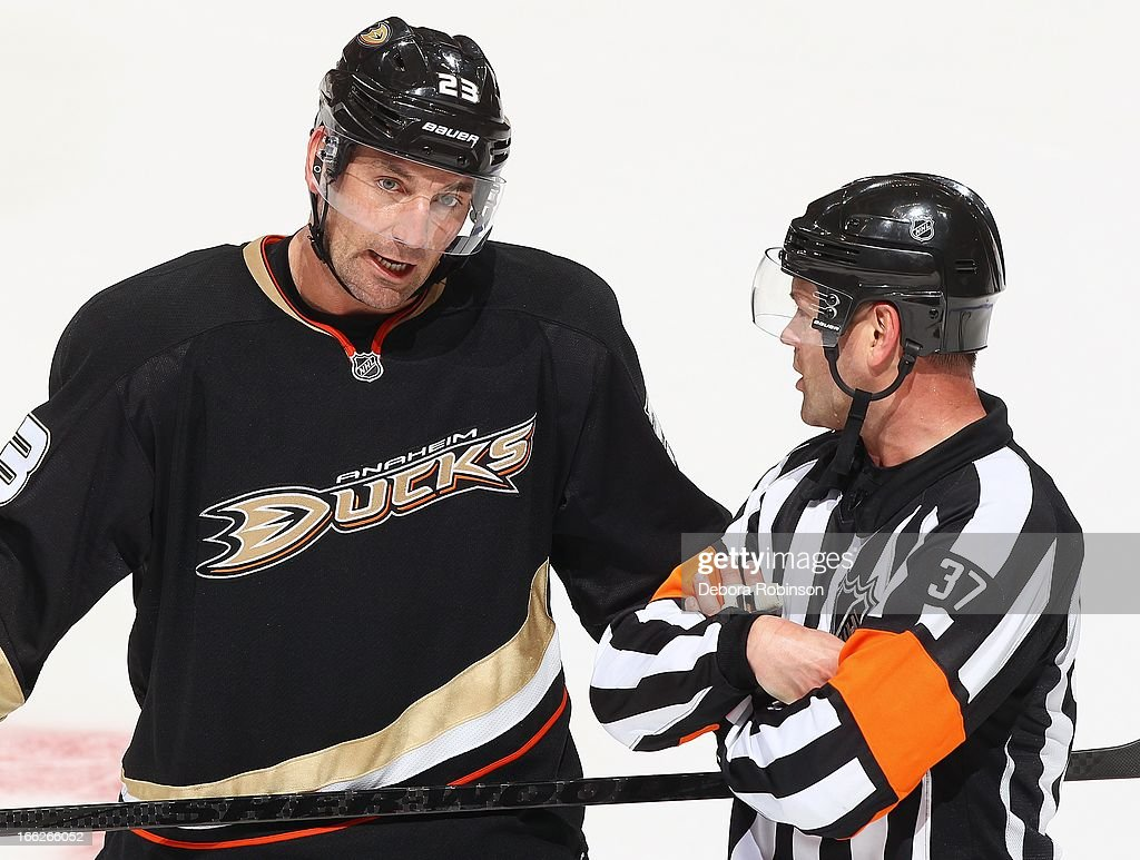 Francois Beauchemin #23 of the Anaheim Ducks discusses a call with referee Kyle Rehman #37 against the Colorado Avalanche April 10, 2013 at Honda Center in Anaheim, California.