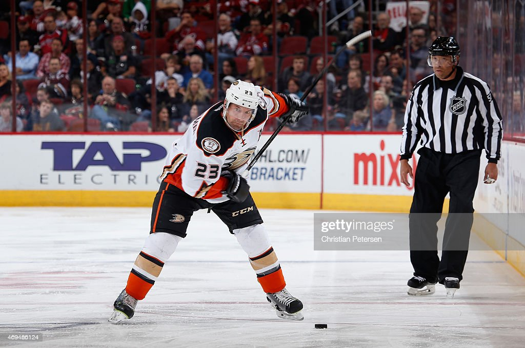 Francois Beauchemin of the Anaheim Ducks dumps the puck during the NHL game against the Arizona Coyotes at Gila River Arena on April 11 2015 in...