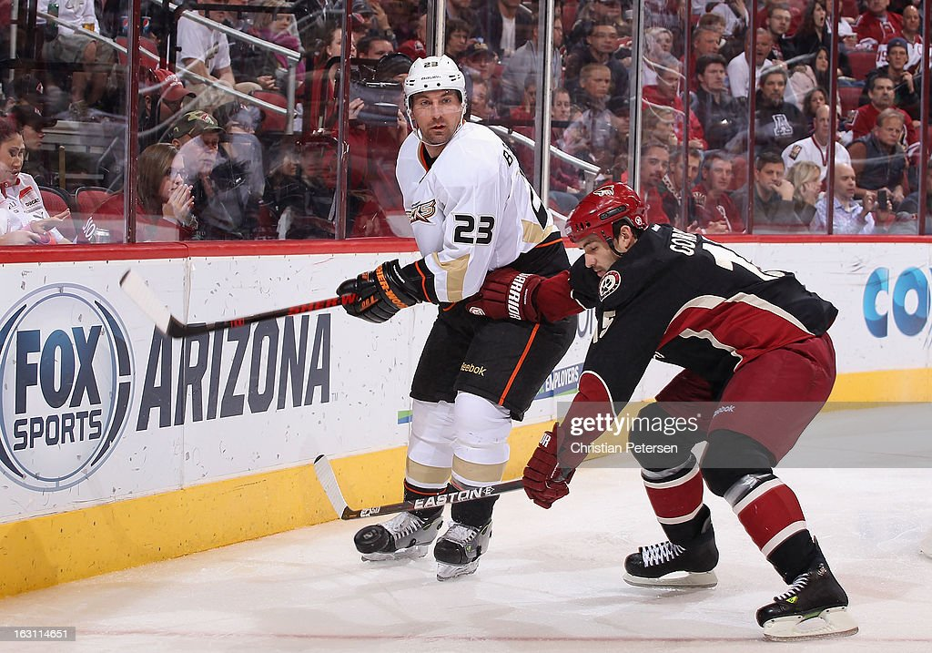 <a gi-track='captionPersonalityLinkClicked' href=/galleries/search?phrase=Francois+Beauchemin&family=editorial&specificpeople=604125 ng-click='$event.stopPropagation()'>Francois Beauchemin</a> #23 of the Anaheim Ducks flips the puck past <a gi-track='captionPersonalityLinkClicked' href=/galleries/search?phrase=Boyd+Gordon&family=editorial&specificpeople=209395 ng-click='$event.stopPropagation()'>Boyd Gordon</a> #15 of the Phoenix Coyotes during the third period of the NHL game at Jobing.com Arena on March 4, 2013 in Glendale, Arizona. The Coyotes defeated the Ducks 5-4 in an overtime shootout.