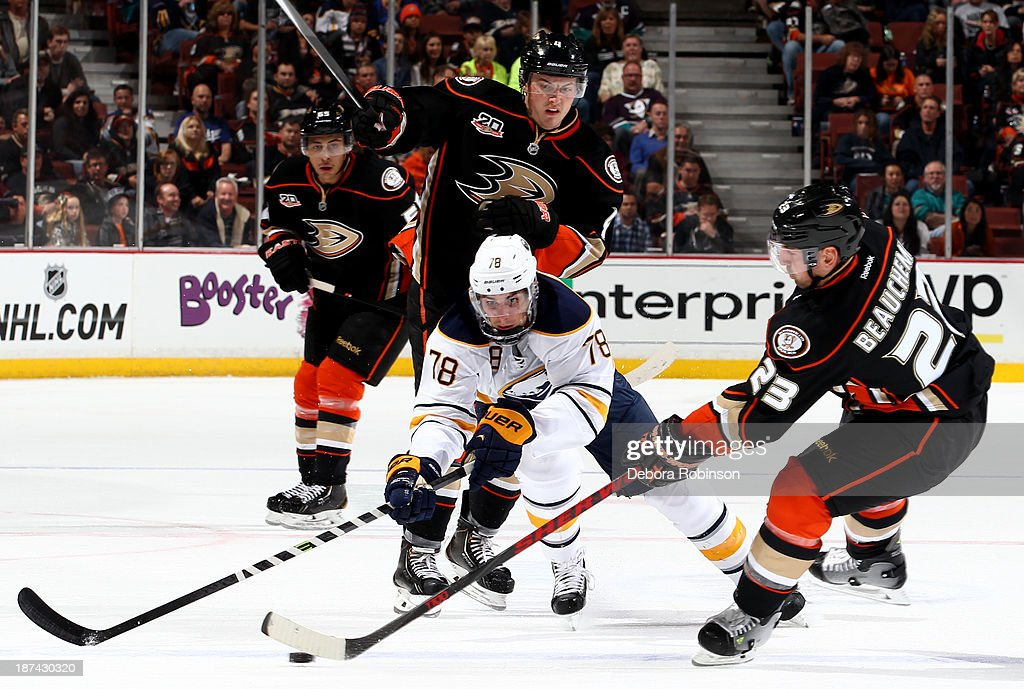 <a gi-track='captionPersonalityLinkClicked' href=/galleries/search?phrase=Francois+Beauchemin&family=editorial&specificpeople=604125 ng-click='$event.stopPropagation()'>Francois Beauchemin</a> #23 of the Anaheim Ducks handles the puck against <a gi-track='captionPersonalityLinkClicked' href=/galleries/search?phrase=Corey+Tropp&family=editorial&specificpeople=5483748 ng-click='$event.stopPropagation()'>Corey Tropp</a> #78 of the Buffalo Sabres during a game at Honda Center on November 8, 2013 in Anaheim, California.