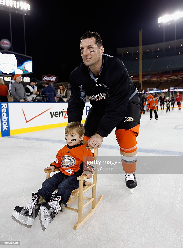 <a gi-track='captionPersonalityLinkClicked' href=/galleries/search?phrase=Francois+Beauchemin&family=editorial&specificpeople=604125 ng-click='$event.stopPropagation()'>Francois Beauchemin</a> #23 of the Anaheim Ducks skates with his son during the family skate after the team practice for the 2014 Coors Light NHL Stadium Series against the Los Angeles Kings at Dodger Stadium on January 24, 2014 in Los Angeles, California.