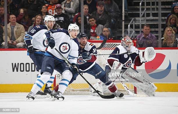 Francois Beauchemin of the Colorado Avalanche defends against Adam Lowry of the Winnipeg Jets infront of Goaltender Semyon Varlamov at the Pepsi...