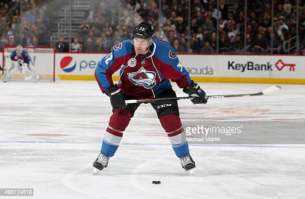 Francois Beauchemin of the Colorado Avalanche looks to pass against the Boston Bruins at the Pepsi Center on October 14 2015 in Denver Colorado The...