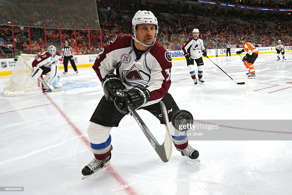 Francois Beauchemin of the Colorado Avalanche tries to control a loose puck against the Philadelphia Flyers in the second period at Wells Fargo...