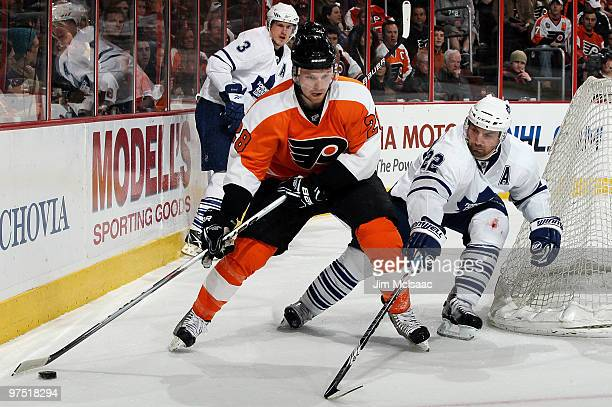 Francois Beauchemin of the Toronto Maple Leafs defends against Claude Giroux of the Philadelphia Flyers on March 7 2010 at Wachovia Center in...