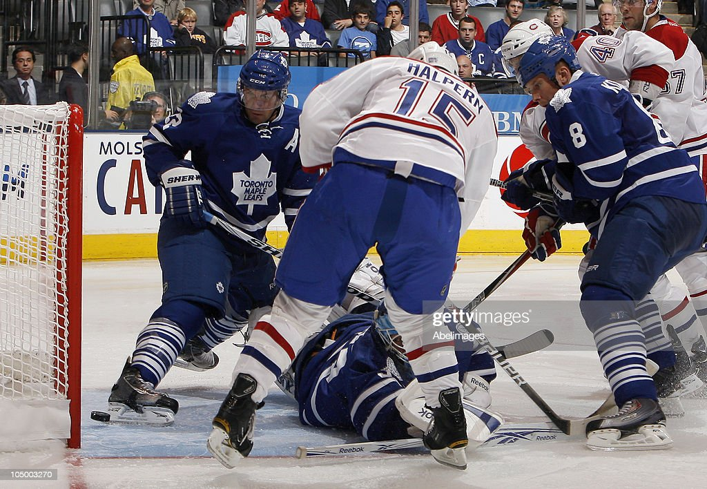<a gi-track='captionPersonalityLinkClicked' href=/galleries/search?phrase=Francois+Beauchemin&family=editorial&specificpeople=604125 ng-click='$event.stopPropagation()'>Francois Beauchemin</a> #22 of the Toronto Maple Leafs watches as <a gi-track='captionPersonalityLinkClicked' href=/galleries/search?phrase=Maxim+Lapierre&family=editorial&specificpeople=718385 ng-click='$event.stopPropagation()'>Maxim Lapierre</a> #40 of the Montreal Canadiens' shot crosses the line during a regular season NHL game against the Toronto Maple Leafs at the Air Canada Centre October 7, 2010 in Toronto, Ontario, Canada.