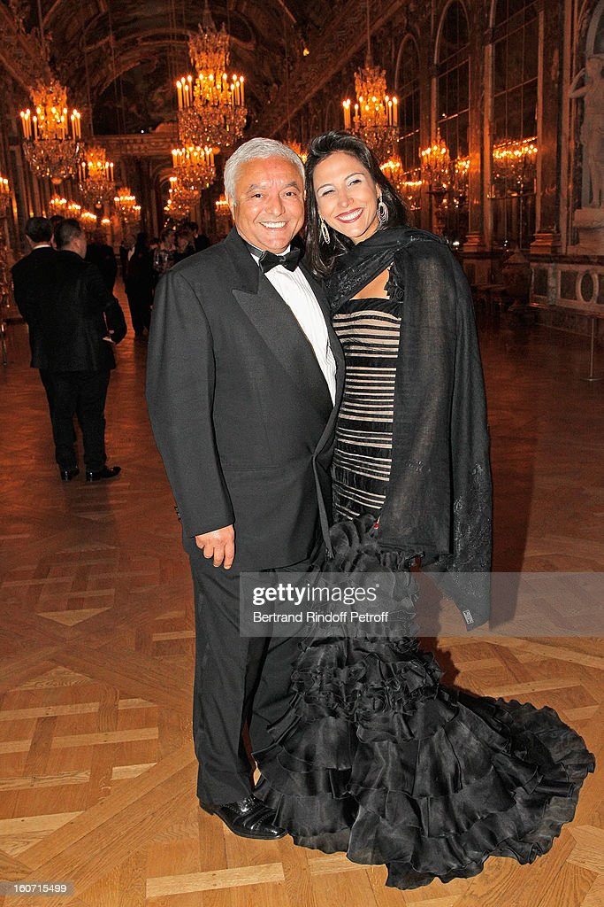 Francois Bennaceur (L) and Cyrine Frad pose in the Hall of Mirrors as they attend the gala dinner of Professor David Khayat's association 'AVEC', at Chateau de Versailles on February 4, 2013 in Versailles, France.