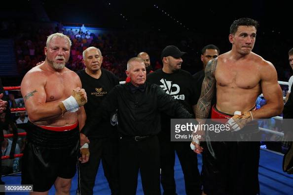 Francois Botha and Sonny Bill Williams wait for the results after their heavyweight bout at the Brisbane Entertainment Centre on February 8 2013 in...