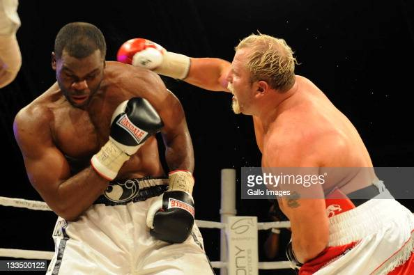 Francois Botha hits Michael Grant during the World Boxing Federation Heavyweight title bout at Monte Casino on November 19 2011 in Johannesburg South...