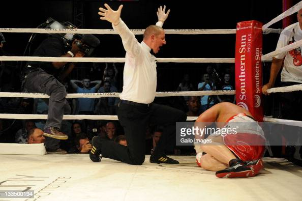 Francois Botha is counted out by referee Ingo Barrabas during the World Boxing Federation Heavyweight title bout against Michael Grant at Monte...