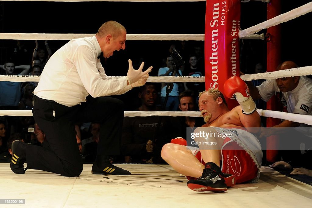 <a gi-track='captionPersonalityLinkClicked' href=/galleries/search?phrase=Francois+Botha&family=editorial&specificpeople=220516 ng-click='$event.stopPropagation()'>Francois Botha</a> (R) is counted out by referee Ingo Barrabas during the World Boxing Federation Heavyweight title bout against Michael Grant at Monte Casino on November 19, 2011 in Johannesburg, South Africa.
