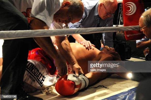 Francois Botha is knocked out during the World Boxing Federation Heavyweight title bout against Michael Grant at Monte Casino on November 19 2011 in...