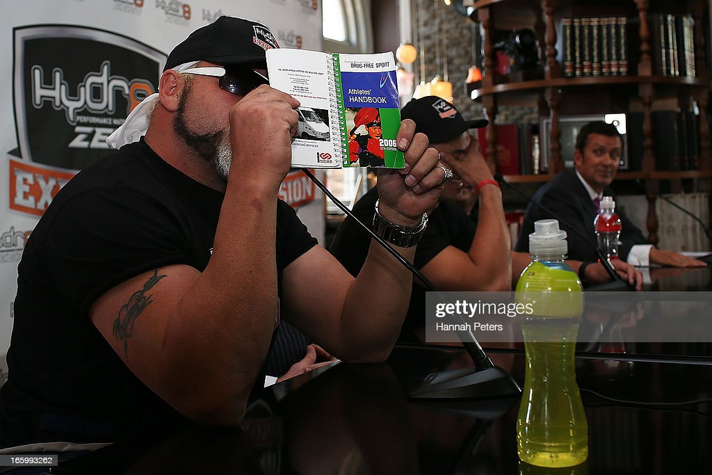 Francois Botha of South Africa holds up a drug free sport handbook during a press conference with New Zealand boxer Joseph Parker at the Northern Steamship Bar on April 8, 2013 in Auckland, New Zealand. Parker will fight Botha in 8 x 3 minute rounds on Thursday 13 June in Auckland.