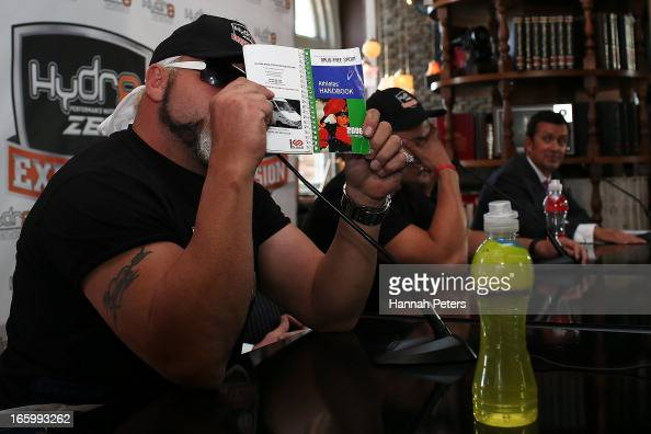 Francois Botha of South Africa holds up a drug free sport handbook during a press conference with New Zealand boxer Joseph Parker at the Northern...