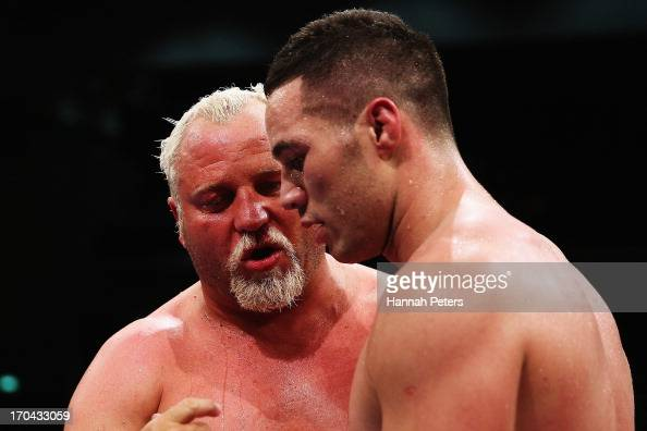 Francois Botha of South Africa talks to Joseph Parker of New Zealand after being knocked out during the Heavyweight Title fight at Trusts Stadium on...