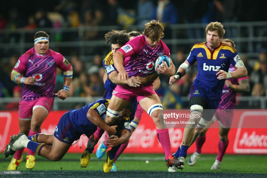 <a gi-track='captionPersonalityLinkClicked' href=/galleries/search?phrase=Francois+Botha&family=editorial&specificpeople=220516 ng-click='$event.stopPropagation()'>Francois Botha</a> of the Bulls is tackled during the round 13 Super Rugby match between the Highlanders and the Bulls at Forsyth Barr Stadium on May 19, 2012 in Dunedin, New Zealand.