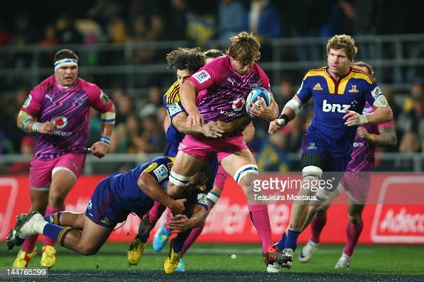 Francois Botha of the Bulls is tackled during the round 13 Super Rugby match between the Highlanders and the Bulls at Forsyth Barr Stadium on May 19...
