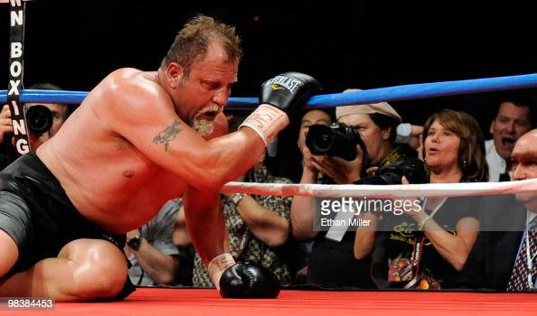 Francois Botha tries to get off the canvas after being knocked down by Evander Holyfield in the eighth round of their heavyweight bout shortly before...