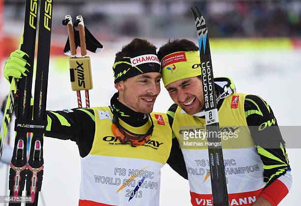 Francois Braud and Jason Lamy Chappuis of France celebrate winning the gold medal in the Men's Team Nordic Combined during the FIS Nordic World Ski...