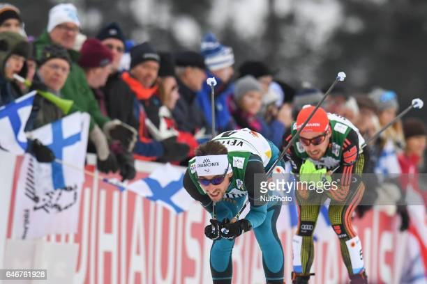 Francois Braud from France in lead ahead of Johannes Rydzek from Germany during Men 10km Nordic Combined final at FIS Nordic World Ski Championship...