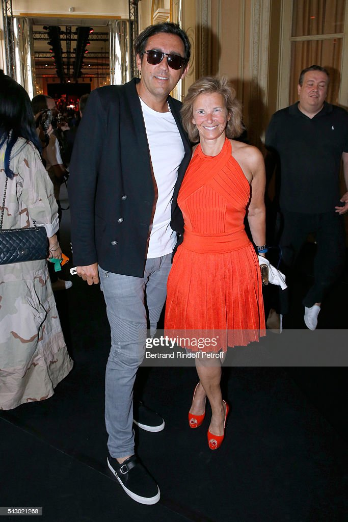 Francois Breavoine and CEO of Warner France Iris Knobloch attends the Balmain Menswear Spring/Summer 2017 show as part of Paris Fashion Week on June 25, 2016 in Paris, France.