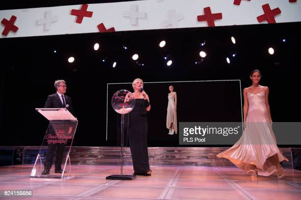Francois Cluzet and Maitena Biraben speak on stage at the 69th Monaco Red Cross Ball Gala at Sporting MonteCarlo on July 28 2017 in MonteCarlo Monaco