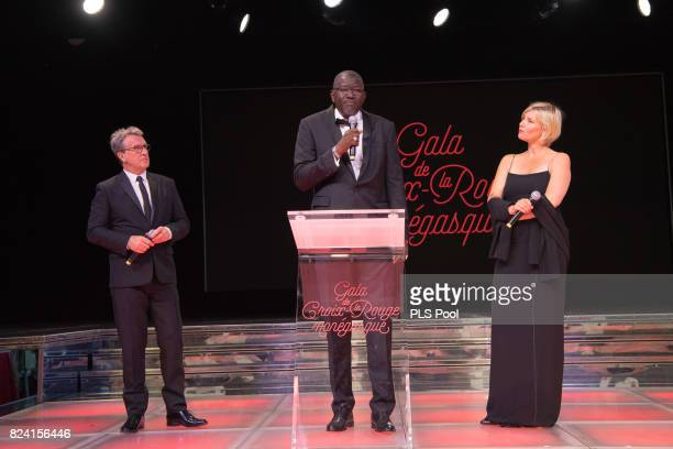 Francois Cluzet Elhadj As Sy and Maitena Biraben speak on stage at the 69th Monaco Red Cross Ball Gala at Sporting MonteCarlo on July 28 2017 in...