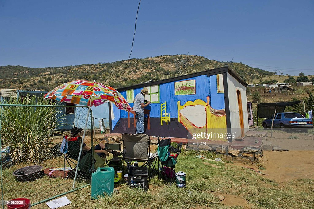 Francois Coetzer paints a shack at the Alaska Informal settlement on March 24, 2013 in Mamelodi, South Africa. The Viva Foundation hosted the second Mams Art Festival at the informal settlement over the weekend. The art festival focuses on creating the world's first living art gallery by transforming shacks into art work.