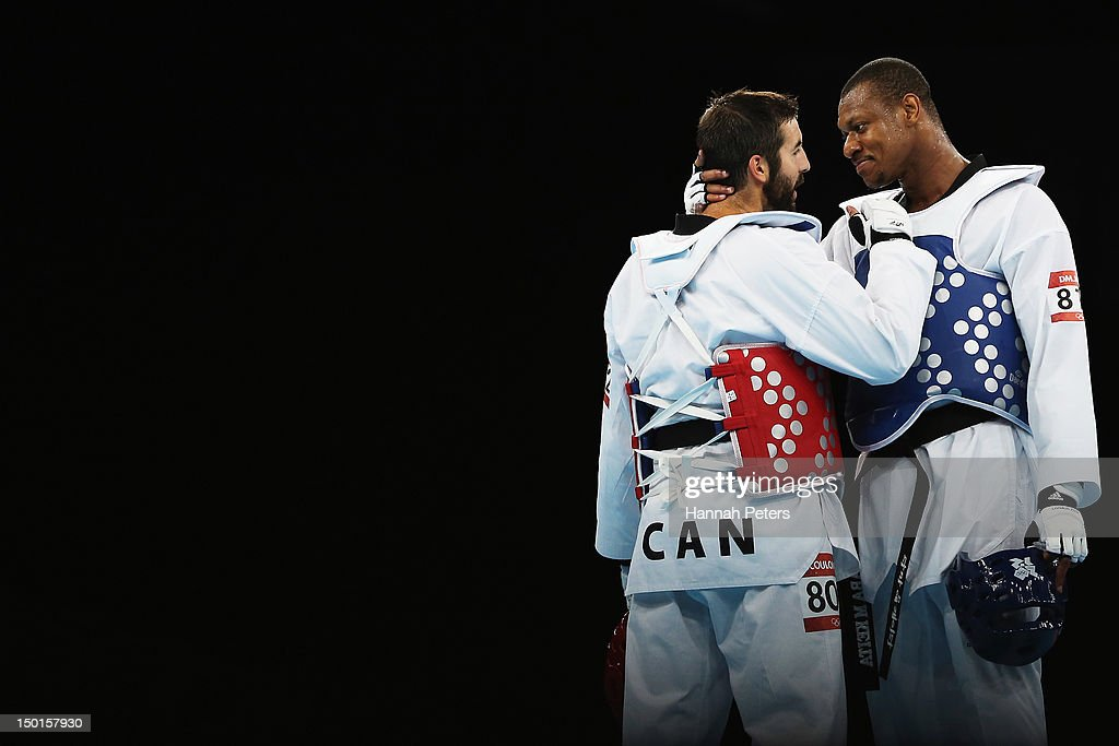 Francois CoulombeFortier of Canada hugs Daba Modibo Keita of Mali following the quarterfinal on Day 15 of the London 2012 Olympic Games at ExCeL on...