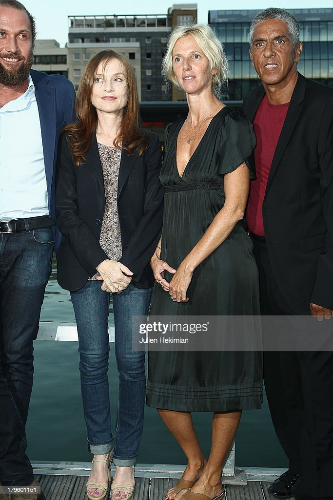 Francois Damiens, <a gi-track='captionPersonalityLinkClicked' href=/galleries/search?phrase=Isabelle+Huppert&family=editorial&specificpeople=662796 ng-click='$event.stopPropagation()'>Isabelle Huppert</a>, <a gi-track='captionPersonalityLinkClicked' href=/galleries/search?phrase=Sandrine+Kiberlain&family=editorial&specificpeople=832890 ng-click='$event.stopPropagation()'>Sandrine Kiberlain</a> and Samy Naceri attend 'Tip Top' Paris Premiere at Mk2 Quai de Seine on September 5, 2013 in Paris, France.