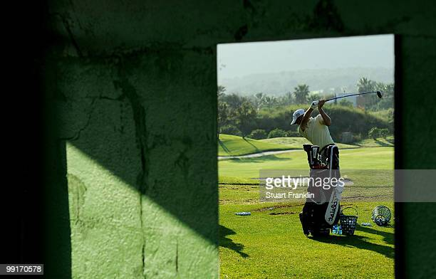 Francois Delamontagne of France is reflected in a mirror as he warms up on the range before the first round of the Open Cala Millor Mallorca at Pula...