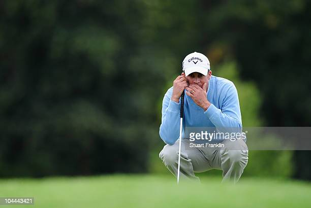 Francois Delamontagne of France lines up his putt on the nineth hole during the third round of the Vivendi cup at Golf de Joyenval on September 25...