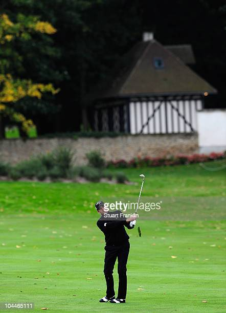 Francois Delamontagne of France plays his approach shot on the 13th hole during the final round of the Vivendi cup at Golf de Joyenval on September...