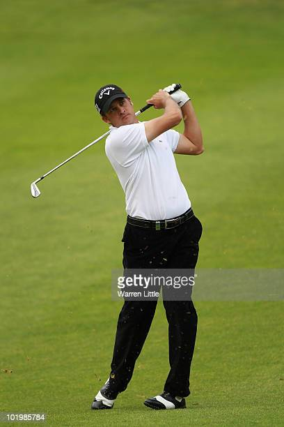 Francois Delamontagne of France plays his second shot into the 16th green during the second round of the Estoril Open de Portugal at Penha Longa...