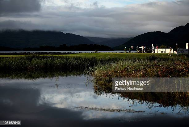 Francois Delamontagne of France tee's off at the 1st watched by David Howell of England and Anders Hansen of Denmark during the second round of the 3...