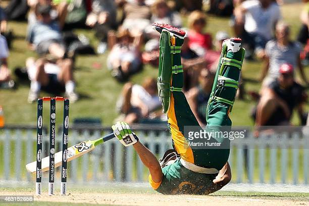 Francois du Plessis of South Africa slids into his crease during the ICC Cricket World Cup match between South Africa and New Zealand at Hagley Park...
