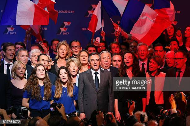 Francois Fillon candidate for the rightwing primaries ahead of the French 2017 presidential election sings the national anthem with supporters at the...