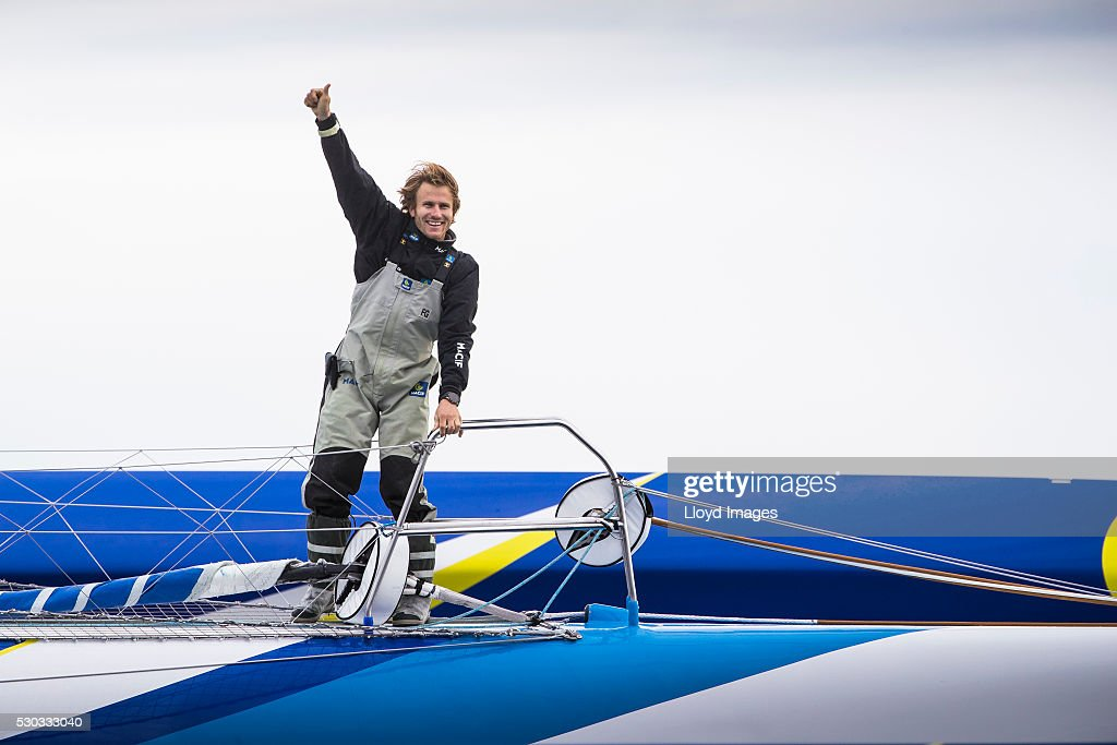Francois Gabart on board his MACIF 105ft trimaran, celebrates after winning the 'Transat Bakerly' solo transatlantic yacht race May 10, 2016 on the Hudson River in New York City. The yachtsman set a new world record for the solo transatlantic crossing in 8 days, 8 hours 54 minutes and 39 seconds. The race started in Plymouth, UK on Monday May 3rd.
